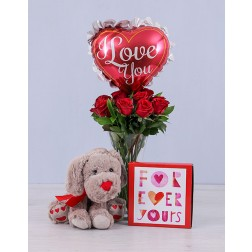 Red roses in a vase, chocolates, teddy & balloon for Valentines Day